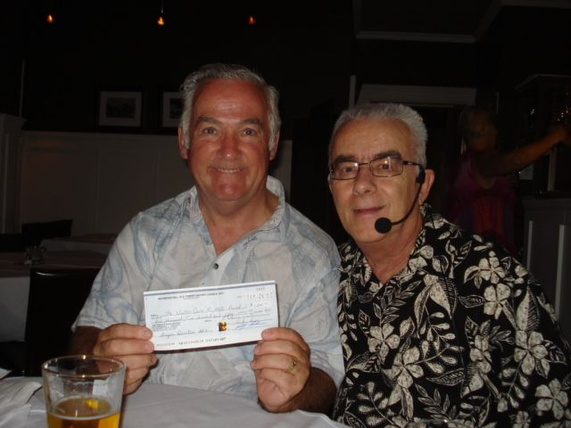 Dennis LaPlante is shown handing Derek Walton a cheque for $1,250 from the RHOTHL golf tournament. Derek was diagnosed with ALS (Lou Gehrig's disease) in 2002. Since that time Derek has raised $250,000 for ALS research. Derek has completed a tandem skydive for the last three years and the cheque assisted with his fourth tandem skydive fundraiser that occurred on August 18th, 2012. Derek & Diane Walton want to thank the RHOTHL for the generous donation.